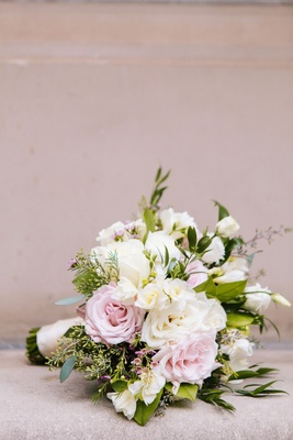 loosely structured blush and ivory wedding bouquet with greenery rose flowers