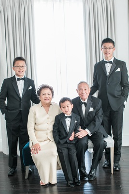couple celebrating 50th anniversary post with their grandsons
