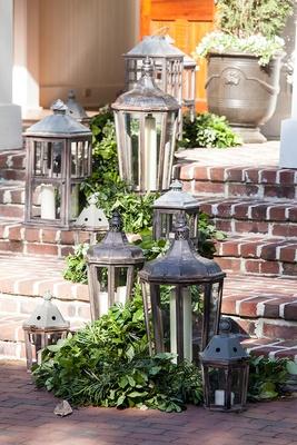 Outdoor wedding reception brick steps Montage Palmetto Bluff lanterns and green garlands decorations
