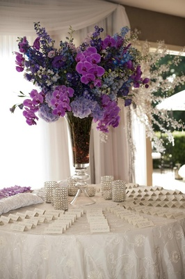 White embroidered linen table with purple flower arrangement