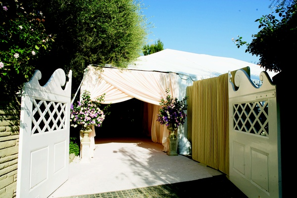 ... Garage doors opened to light pink tent · Man reading wedding ... & Elegant Backyard Wedding with Romantic Floral Design in California ...