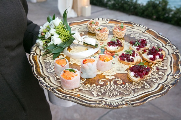 Wedding vow renewal tray passed appetizer hors doeuvre on tray sushi crostini bruschetta beets fish