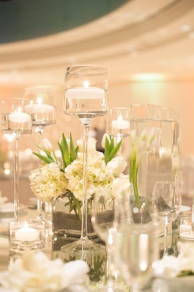 Ivory hydrangea blossoms and clear glass vases