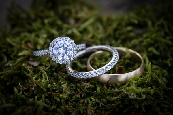 diamond engagement ring bands gold moss outdoors wedding bride groom