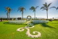 lawn ceremony beach floral aisle runner outdoors hotel del coronado california wedding design