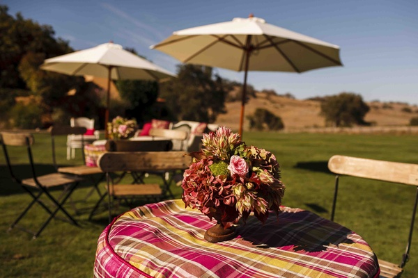 Outdoor ranch cocktail hour with pink plaid table covers