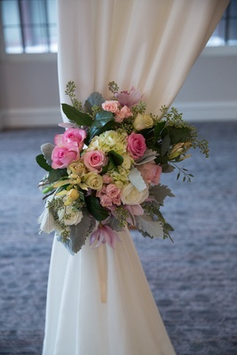 Wedding ceremony draped structure, tieback of roses, hydrangeas, orchids, in blush, mint, pearl
