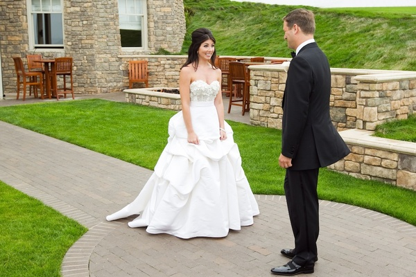 Bride and groom see each other for first time before wedding