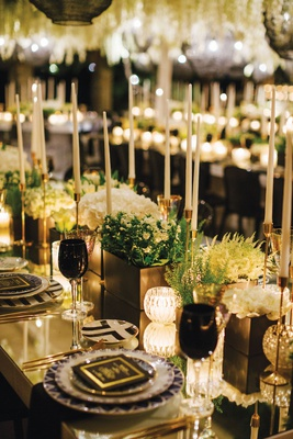 wedding reception modern black white geometric designs taper candles greenery black glassware goblet