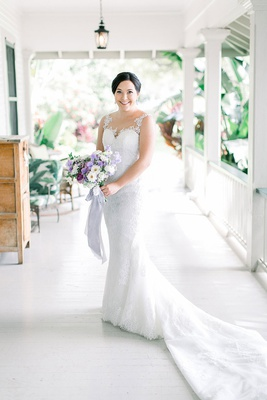 bride in illusion wedding dress lace with sheer neckline purple bouquet plantation porch hawaii