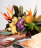 wedding reception tropical table with purple green brassica cabbage yellow protea bird of paradise