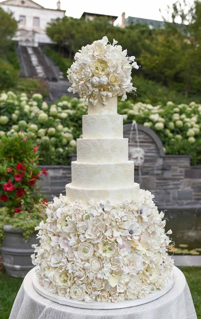 damask wedding cake with abundance of sugar flowers