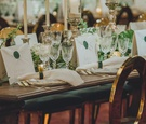 wedding reception hotel gold oval back chairs wood table gold flatware antique cut crystal wax seal