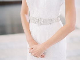 Bride in a JINZA Couture Bridal dress with chantilly lace, sash with rhinestones and beading