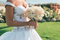 bouquet of white and pink flowers carried by bride