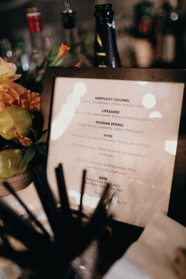 wedding reception cocktail hour wood frame cocktail menu bar
