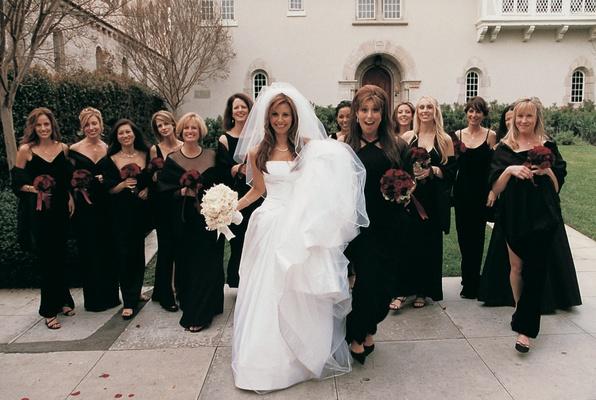White Vera Wang wedding dress and black bridesmaid dresses