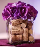 Cocktail hour centerpieces with corks and flowers