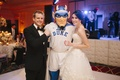 Bride and groom with Duke Devils mascot at reception