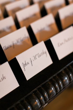 calligraphy place cards with simple white stationery and black writing
