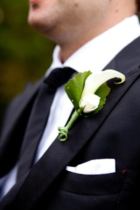 Groom's suit lapel with pocket square and rose and calla lily boutonniere