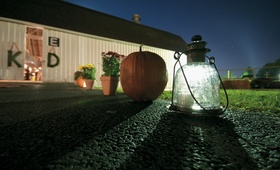 Pumpkin and lantern lead way to barn wedding reception