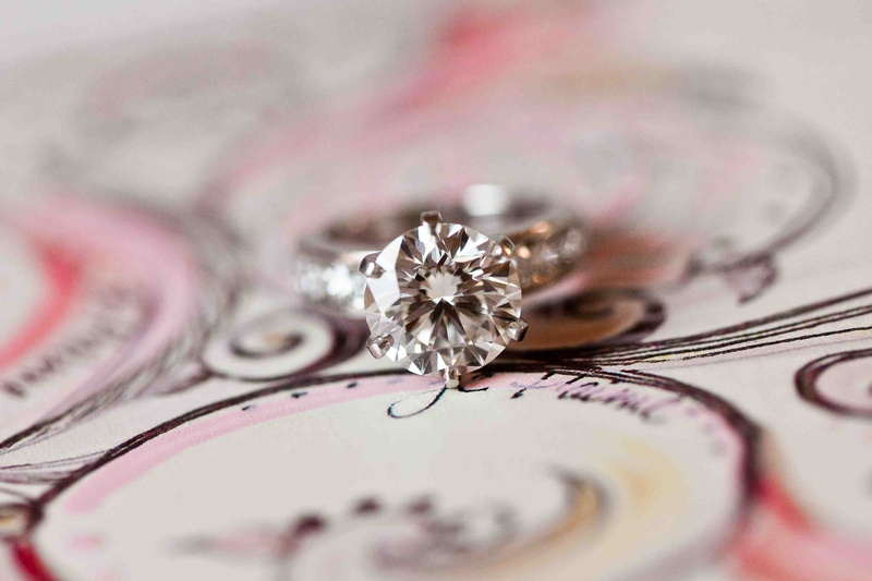 Six prong diamond engagement ring with round center stone