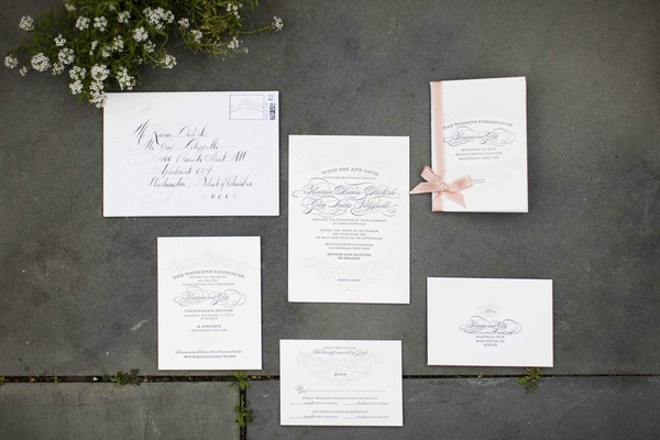 Wedding invitations with calligraphy and ribbon