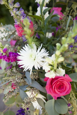 colorful floral centerpiece, white spider mum, pink rose, purple flowers, greenery