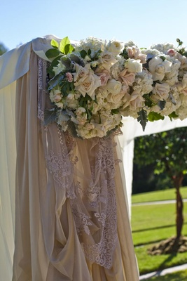 Ceremony altar with lace drapery and blush flowers