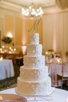 wedding reception ballroom five layer wedding cake flower vine design large initial cake topper