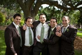Groom with groomsmen in brown suits and light green ties