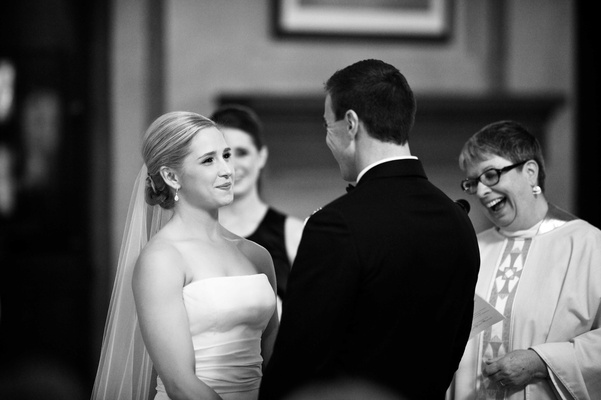 Black and white photo of bride in a strapless Vera Wang dress, veil with groom in a black tuxedo