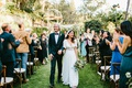 bohemian bride and groom wedding on grass lawn chuppah jewish ceremony outdoor