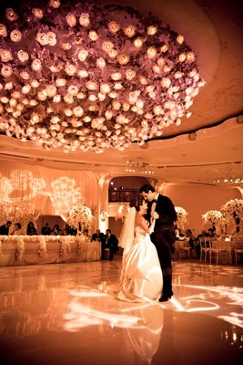 Armenian newlyweds dancing in ballroom