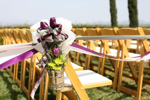 Chrome pail with mums, tulips, and lavender on ceremony chair
