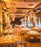 wedding reception the drake hotel chicago tall columns round table gold chair tall centerpiece