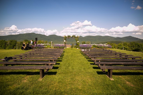 outdoor vermont ceremony mountains clouds blue sky rustic wedding