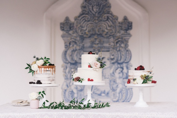 wedding cake selections three cakes with flowers berries greenery outdoor courtyard wedding