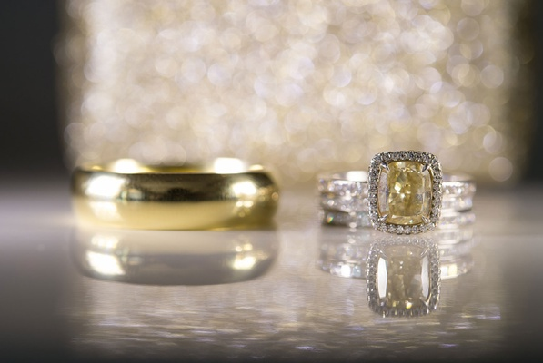 yellow gold radiant cut diamond with halo in white gold, plain yellow gold men's wedding band