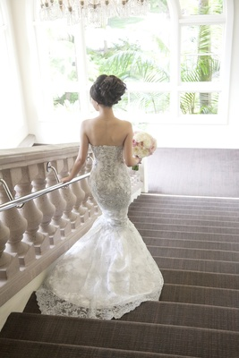 Bride walking down steps in silver beading mermaid dress