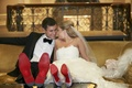 Couple wearing Christian Louboutin shoes kissing