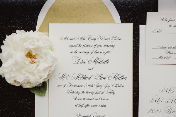 Gold envelope liner white invitation with black calligraphy and flower reply card envelope