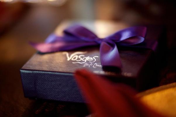 Wedding favors in purple box with purple ribbon