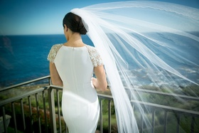 back of bride flowing veil pacific ocean california wedding epic beautiful shot wind
