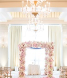 wedding ceremony casa del mar ivory drapery chandelier pink rose petals lining aisle chuppah gold