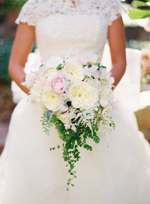 Ivory and light pink wedding bouquet with garden rose and peony flowers accented with green verdure