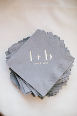 grey cocktail napkins with initials in lowercase and wedding date