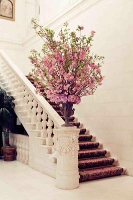Lobby of wedding reception pink flowers in urn