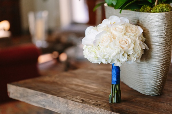 white rose nosegay bridesmaid bouquet tied with royal blue ribbon